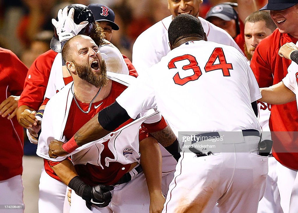<a gi-track='captionPersonalityLinkClicked' href=/galleries/search?phrase=Mike+Napoli&family=editorial&specificpeople=525007 ng-click='$event.stopPropagation()'>Mike Napoli</a> #12 is congratulated by <a gi-track='captionPersonalityLinkClicked' href=/galleries/search?phrase=David+Ortiz&family=editorial&specificpeople=175825 ng-click='$event.stopPropagation()'>David Ortiz</a> #34 of the Boston Red Sox at home plate after hitting a walk-off home run in the 11th inning against the New York Yankees during the game on July 22, 2013 at Fenway Park in Boston, Massachusetts.