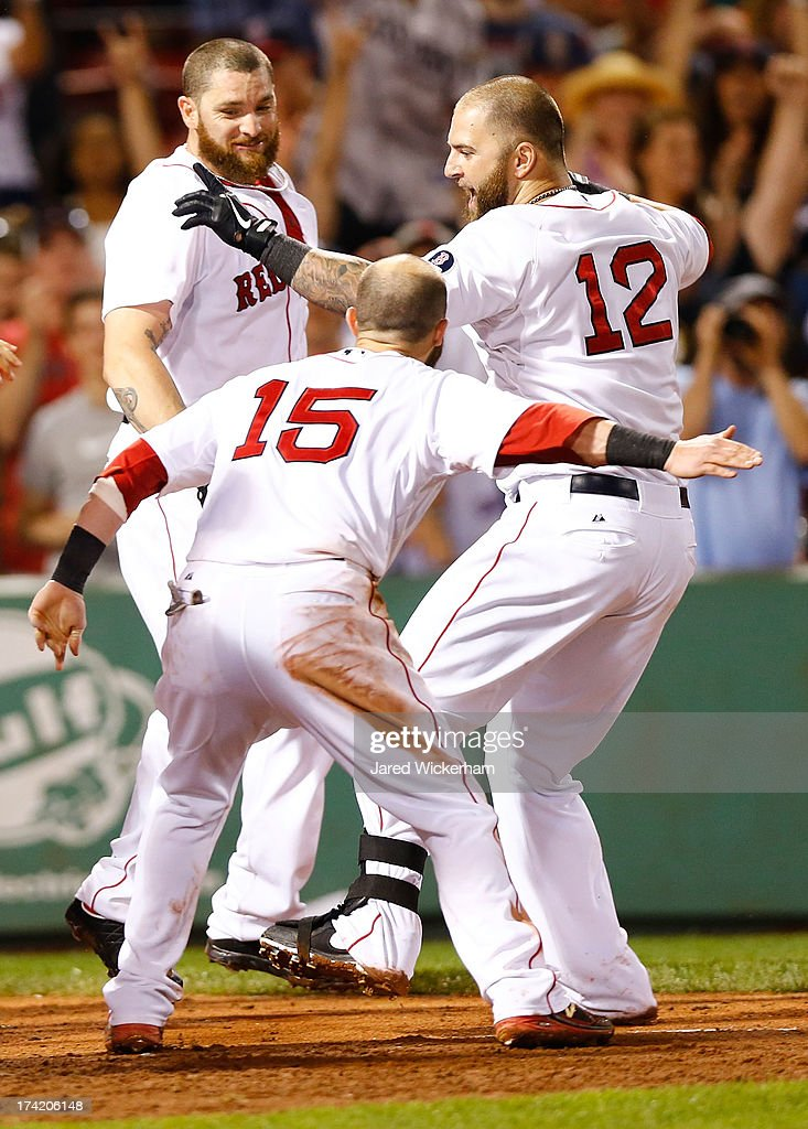 <a gi-track='captionPersonalityLinkClicked' href=/galleries/search?phrase=Mike+Napoli&family=editorial&specificpeople=525007 ng-click='$event.stopPropagation()'>Mike Napoli</a> #12 is congratulated by <a gi-track='captionPersonalityLinkClicked' href=/galleries/search?phrase=Dustin+Pedroia&family=editorial&specificpeople=836339 ng-click='$event.stopPropagation()'>Dustin Pedroia</a> #15 of the Boston Red Sox at home plate after hitting a walk-off home run in the 11th inning against the New York Yankees during the game on July 22, 2013 at Fenway Park in Boston, Massachusetts.