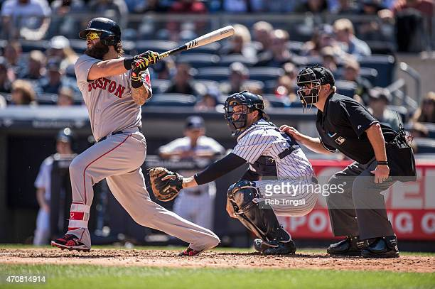 Mike Napoli of the Boston Red Sox bats during the game against the New York Yankees at Yankee Stadium on Saturday April 11 2015 in the Bronx borough...