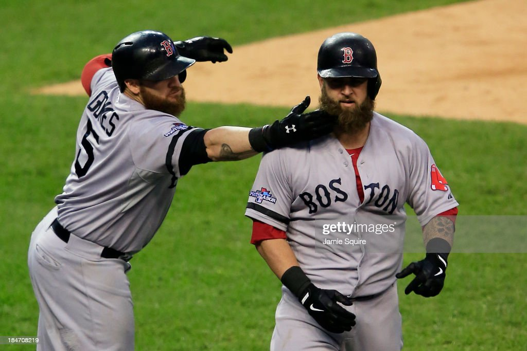 Mike Napoli of the Boston Red Sox celebrates his homerun with Jonny Gomes in the seventh inning against the Detroit Tigers during Game Three of the...