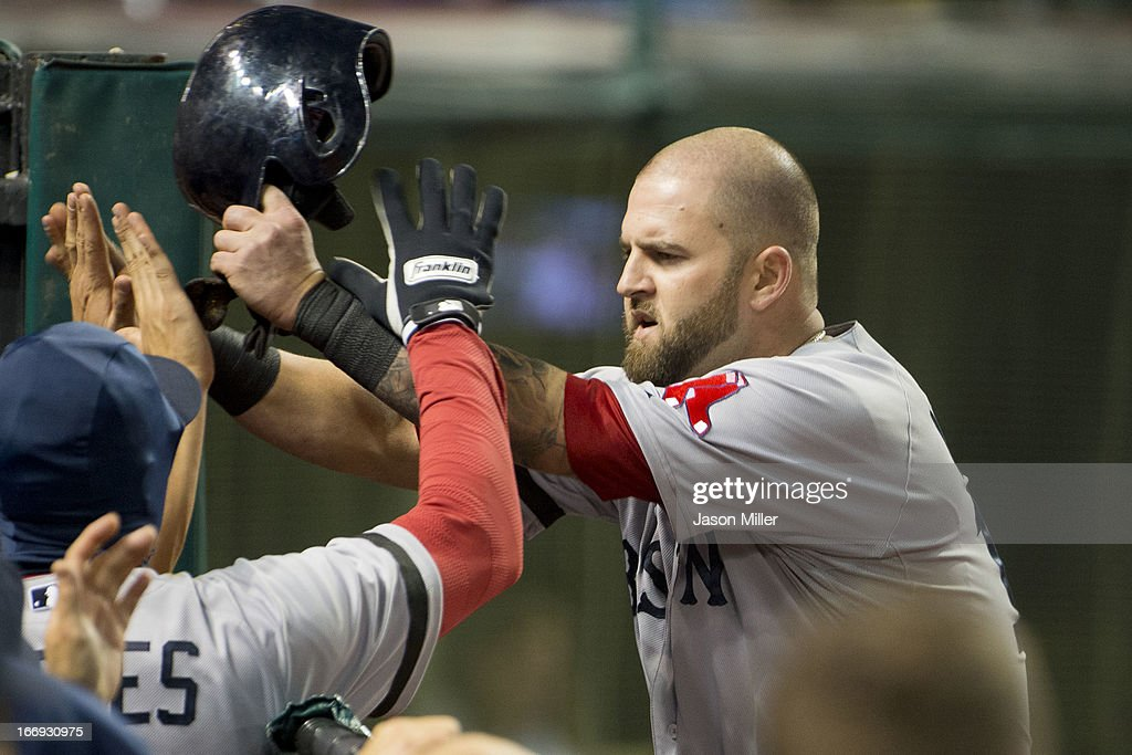 <a gi-track='captionPersonalityLinkClicked' href=/galleries/search?phrase=Mike+Napoli&family=editorial&specificpeople=525007 ng-click='$event.stopPropagation()'>Mike Napoli</a> #12 of the Boston Red Sox celebrates in the dugout after scoring in the seventh inning against the Cleveland Indians at Progressive Field on April 18, 2013 in Cleveland, Ohio.