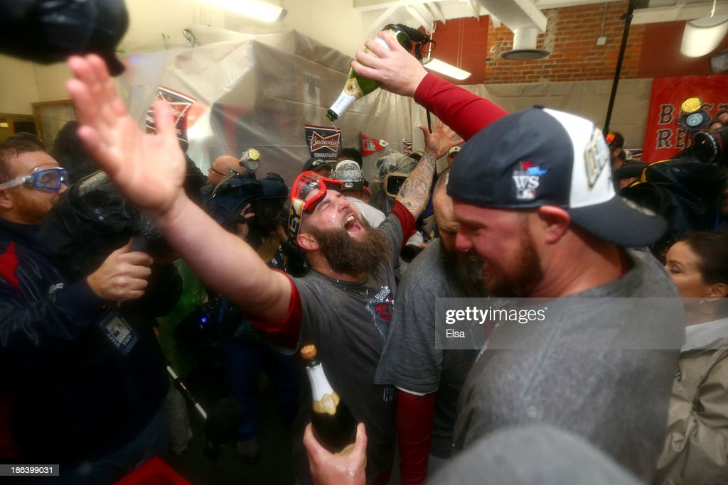 Mike Napoli of the Boston Red Sox celebrates in the locker room after defeating the St Louis Cardinals 61 in Game Six of the 2013 World Series at...