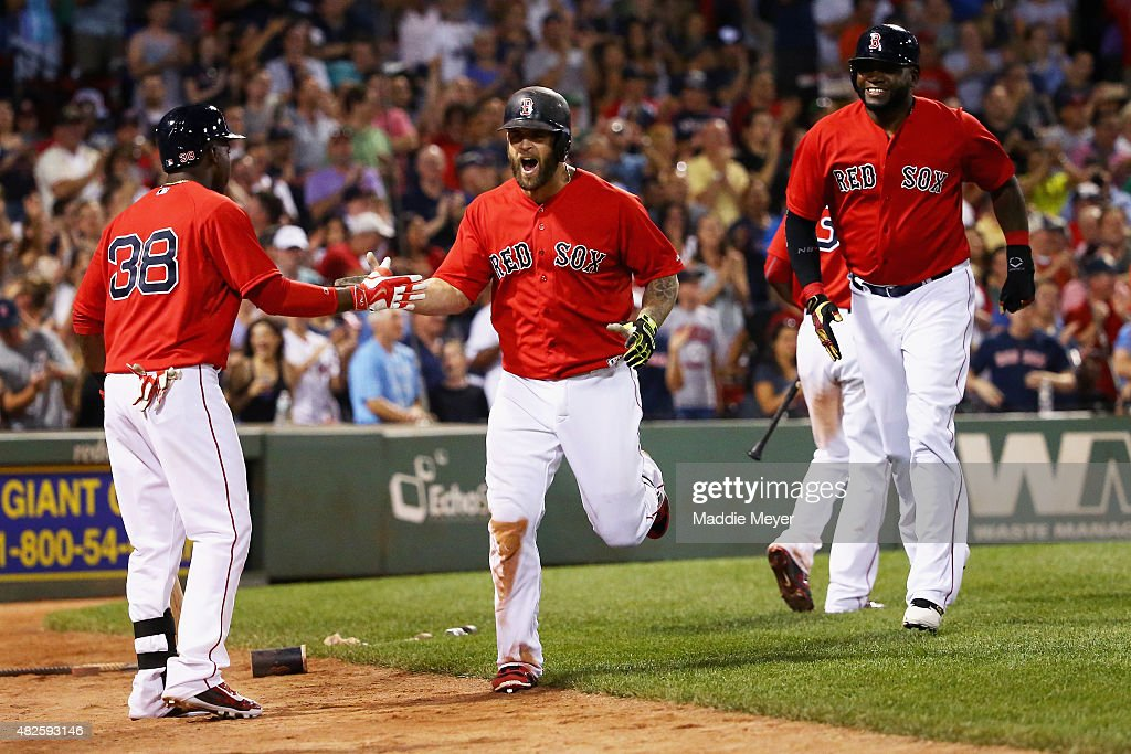 Mike Napoli of the Boston Red Sox celebrates with Rusney Castillo after hitting a two run homer during the seventh inning against the Tampa Bay Rays...