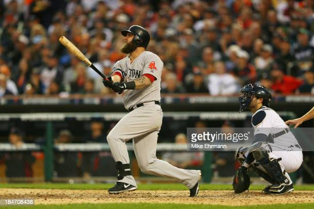 Mike Napoli of the Boston Red Sox hits a seventh inning homerun against the Detroit Tigers during Game Three of the American League Championship...