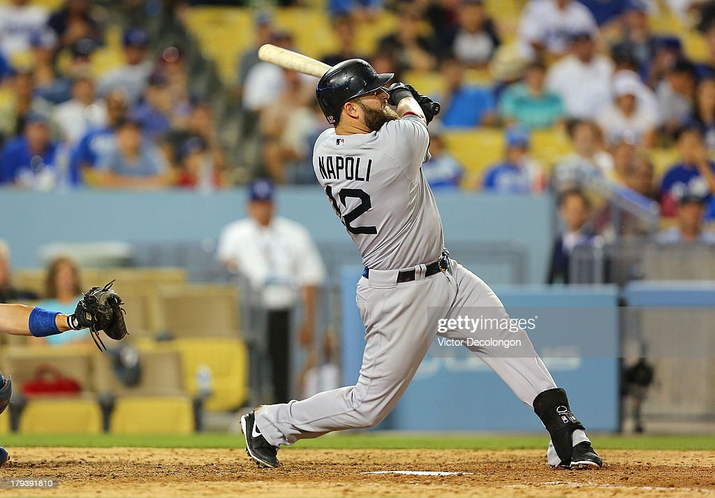 <a gi-track='captionPersonalityLinkClicked' href=/galleries/search?phrase=Mike+Napoli&family=editorial&specificpeople=525007 ng-click='$event.stopPropagation()'>Mike Napoli</a> #12 of the Boston Red Sox hits a two-run home run to left field driving in Dustin Pedroia #15 (not in photo) in the ninth inning against pitcher Brandon League #43 of the Los Angeles Dodgers (not in photo) during the MLB game at Dodger Stadium on August 25, 2013 in Los Angeles, California. The Red Sox defeated the Dodgers 8-1.