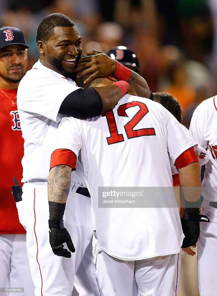 <a gi-track='captionPersonalityLinkClicked' href=/galleries/search?phrase=Mike+Napoli&family=editorial&specificpeople=525007 ng-click='$event.stopPropagation()'>Mike Napoli</a> #12 of the Boston Red Sox is congratulated by <a gi-track='captionPersonalityLinkClicked' href=/galleries/search?phrase=David+Ortiz&family=editorial&specificpeople=175825 ng-click='$event.stopPropagation()'>David Ortiz</a> #34 of the Boston Red Sox at home plate after hitting a walk-off home run in the 11th inning against the New York Yankees during the game on July 22, 2013 at Fenway Park in Boston, Massachusetts.