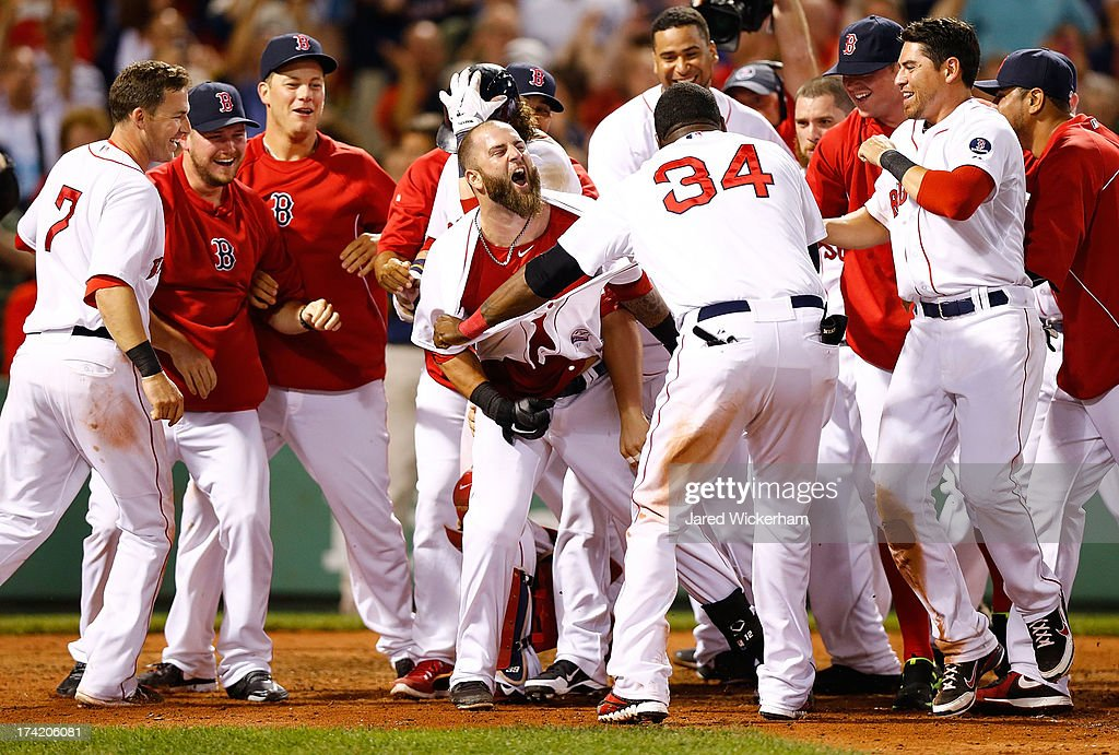 <a gi-track='captionPersonalityLinkClicked' href=/galleries/search?phrase=Mike+Napoli&family=editorial&specificpeople=525007 ng-click='$event.stopPropagation()'>Mike Napoli</a> #12 of the Boston Red Sox is congratulated by teammates at home plate after hitting a walk-off home run in the 11th inning against the New York Yankees during the game on July 22, 2013 at Fenway Park in Boston, Massachusetts.