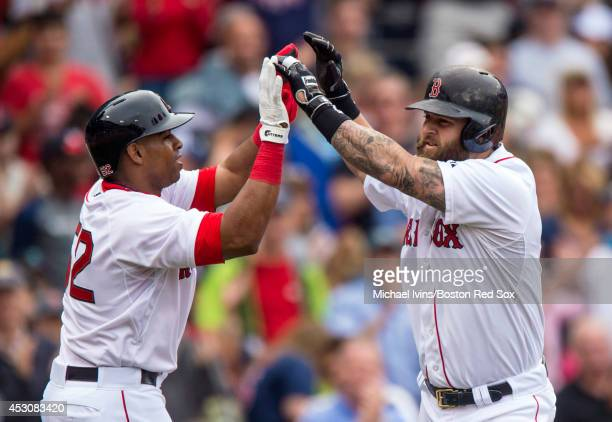 Mike Napoli of the Boston Red Sox is congratulated by Yeonis Cespedes after hitting a tworun home run against the New York Yankees in the second...