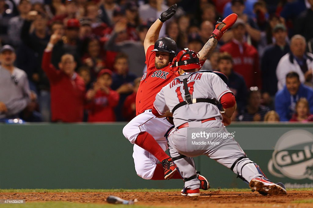Mike Napoli #12 of the Boston Red Sox is tagged out at home by Chris Iannetta #17 of the Los Angeles Angels of Anaheim during the fourth inning at Fenway Park on May 22, 2015 in Boston, Massachusetts.