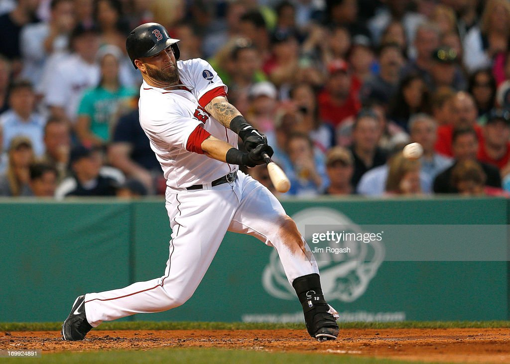 <a gi-track='captionPersonalityLinkClicked' href=/galleries/search?phrase=Mike+Napoli&family=editorial&specificpeople=525007 ng-click='$event.stopPropagation()'>Mike Napoli</a> #12 of the Boston Red Sox knocks in a run on a sacrifice fly against the Texas Rangers in the 2nd inning during a game at Fenway Park on June 4, 2013 in Boston, Massachusetts.