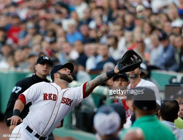 Mike Napoli of the Boston Red Sox makes a catch on a foul ball against the Detroit Tigers in the first inning at Fenway Park on May 17 2014 in Boston...