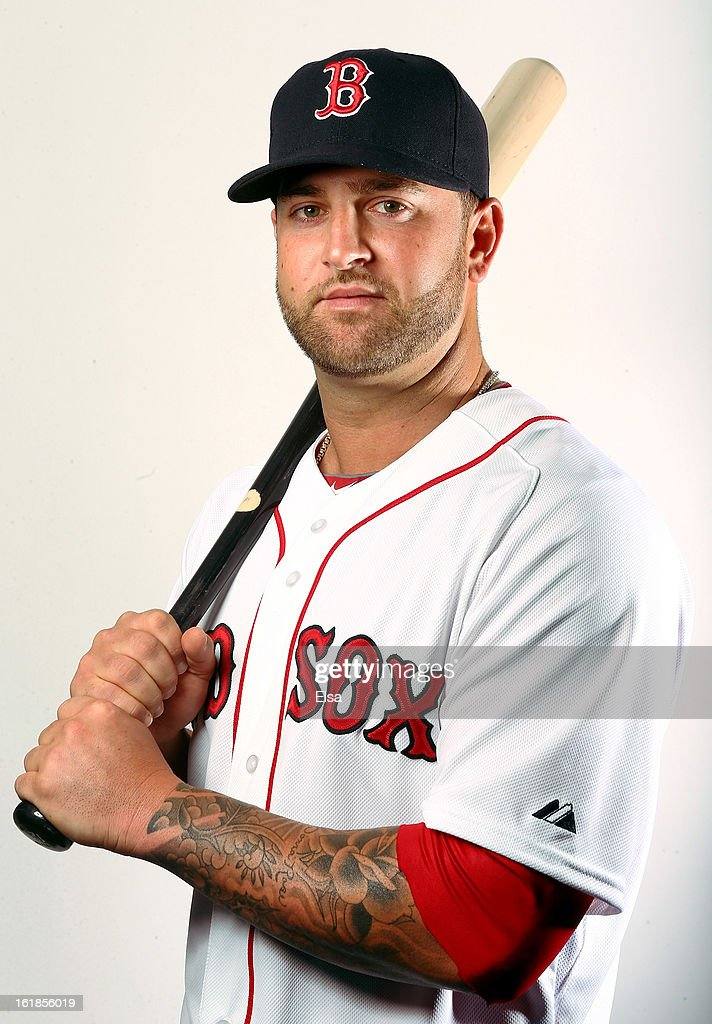 Mike Napoli #12 of the Boston Red Sox poses for a portrait on February 17, 2013 at JetBlue Park at Fenway South in Fort Myers, Florida.