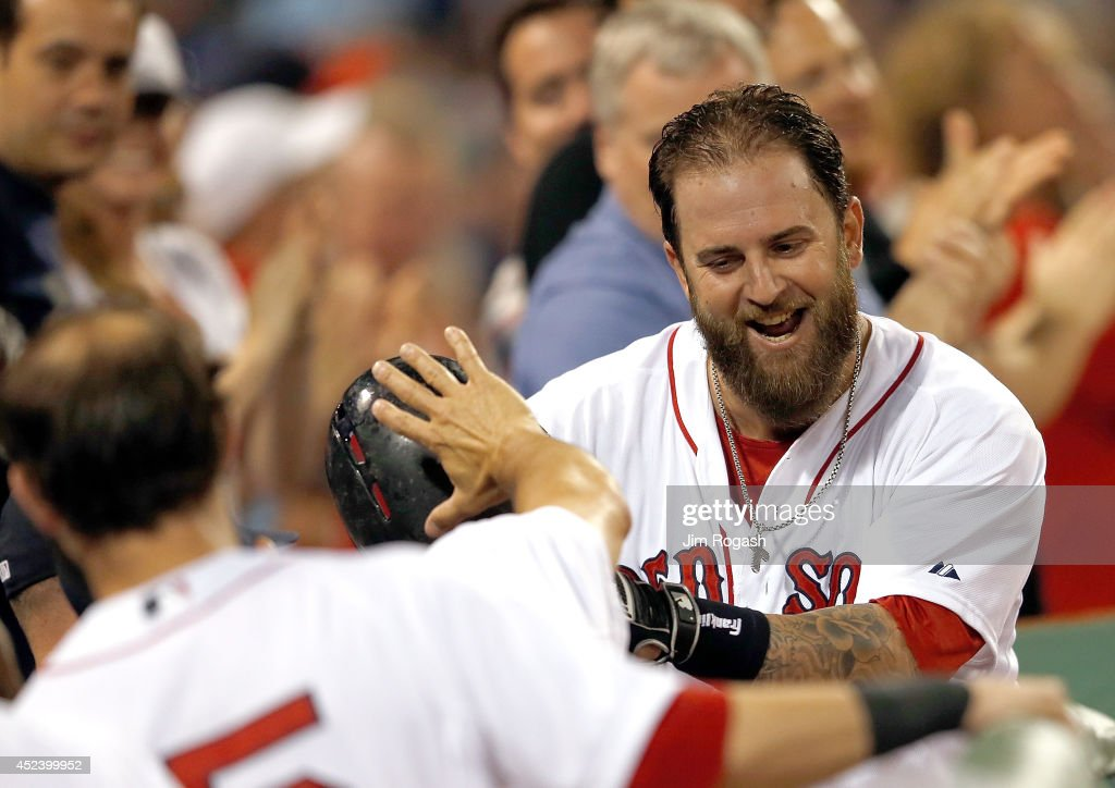 Mike Napoli #12 of the Boston Red Sox reacts after he connected for a home run in the sixth inning against the Kansas City Royals at Fenway Park on July 19, 2014 in Boston, Massachusetts.