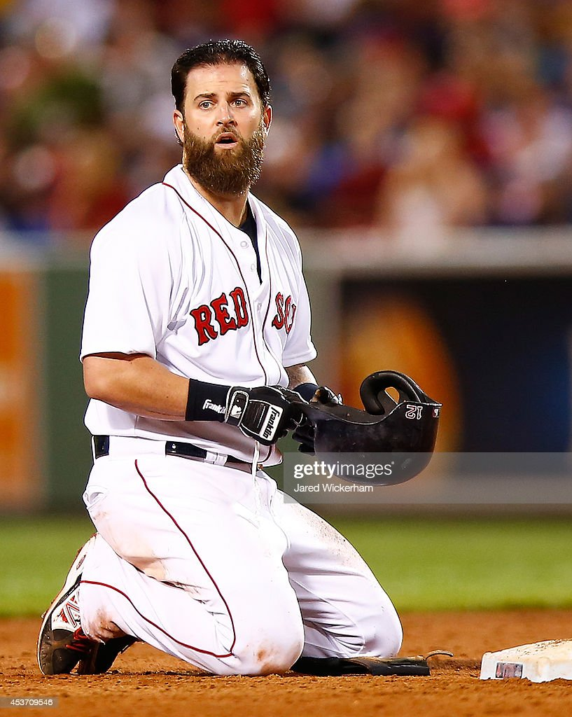 Mike Napoli #12 of the Boston Red Sox reacts after sliding into a double play against the Houston Astros during the game at Fenway Park on August 16, 2014 in Boston, Massachusetts.
