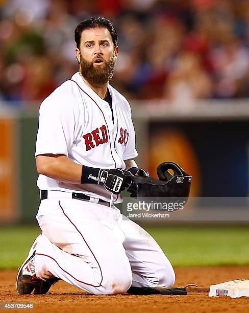 Mike Napoli of the Boston Red Sox reacts after sliding into a double play against the Houston Astros during the game at Fenway Park on August 16 2014...
