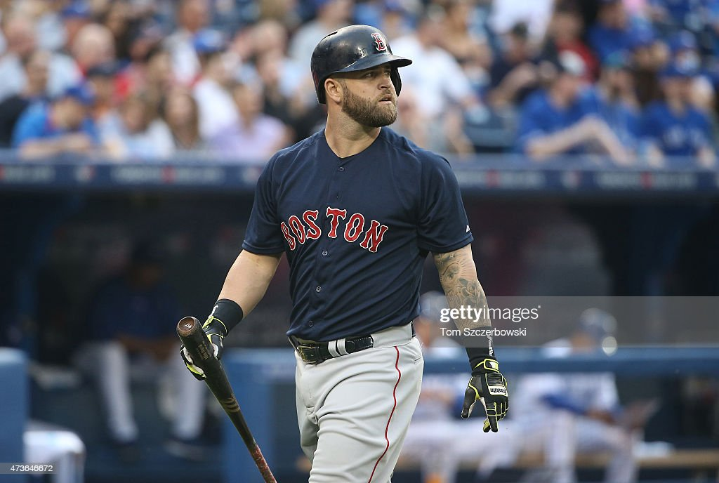 Mike Napoli of the Boston Red Sox reacts after striking out in the second inning during MLB game action against the Toronto Blue Jays on May 8 2015...
