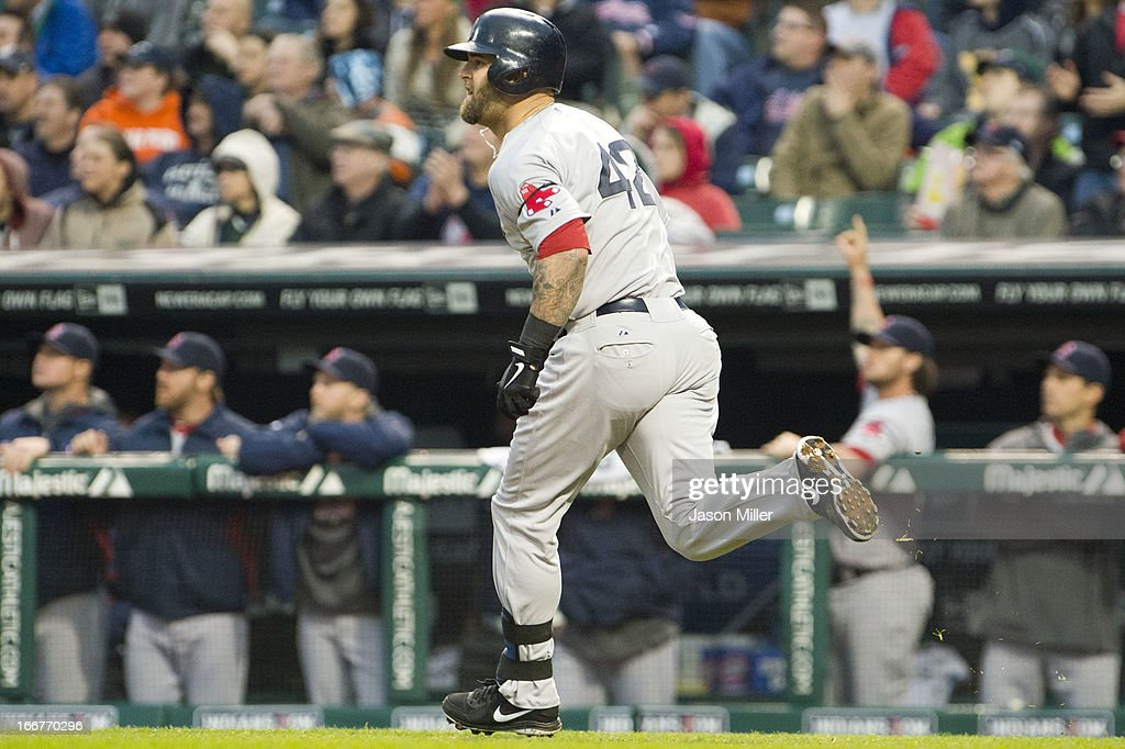 <a gi-track='captionPersonalityLinkClicked' href=/galleries/search?phrase=Mike+Napoli&family=editorial&specificpeople=525007 ng-click='$event.stopPropagation()'>Mike Napoli</a> of the Boston Red Sox runs the bases after hitting a three run RBI double during the second inning against the Cleveland Indians at Progressive Field on April 16, 2013 in Cleveland, Ohio. All uniformed team members are wearing jersey number 42 in honor of Jackie Robinson Day.