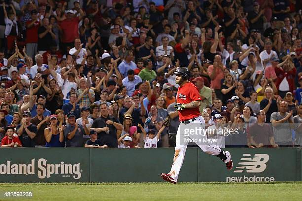 Mike Napoli of the Boston Red Sox runs towards home after hitting a two run homer during the seventh inning against the Tampa Bay Rays at Fenway Park...