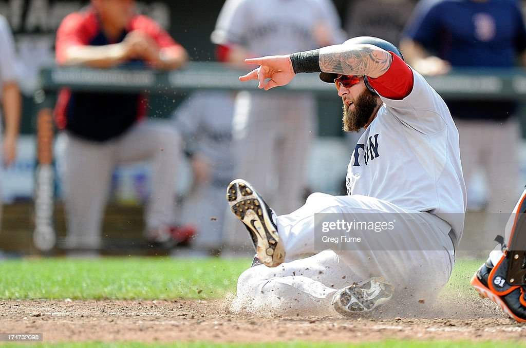 <a gi-track='captionPersonalityLinkClicked' href=/galleries/search?phrase=Mike+Napoli&family=editorial&specificpeople=525007 ng-click='$event.stopPropagation()'>Mike Napoli</a> #12 of the Boston Red Sox slides into home plate in the eighth inning against the Baltimore Orioles at Oriole Park at Camden Yards on July 28, 2013 in Baltimore, Maryland. Boston won the game 5-0.