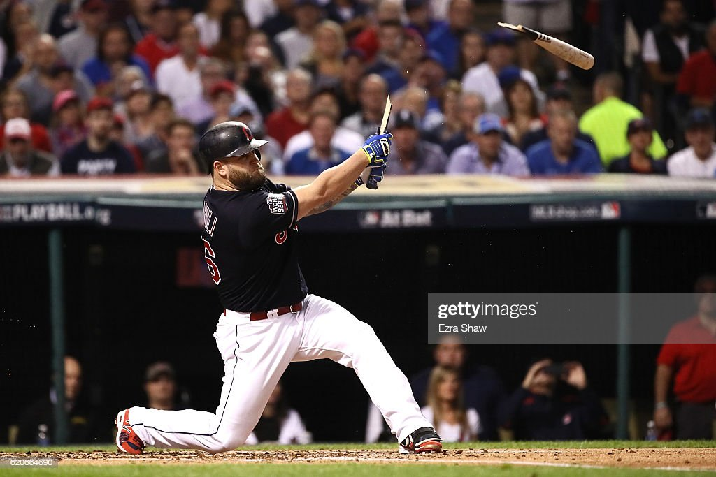Mike Napoli #26 of the Cleveland Indians breaks his bat during the first inning against the Chicago Cubs in Game Seven of the 2016 World Series at Progressive Field on November 2, 2016 in Cleveland, Ohio.