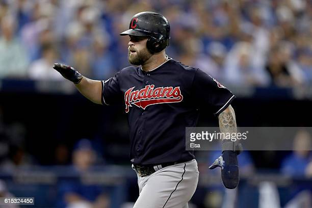 Mike Napoli of the Cleveland Indians celebrates after scoring a run off of a single hit by Jose Ramirez in the sixth inning against Joe Biagini of...