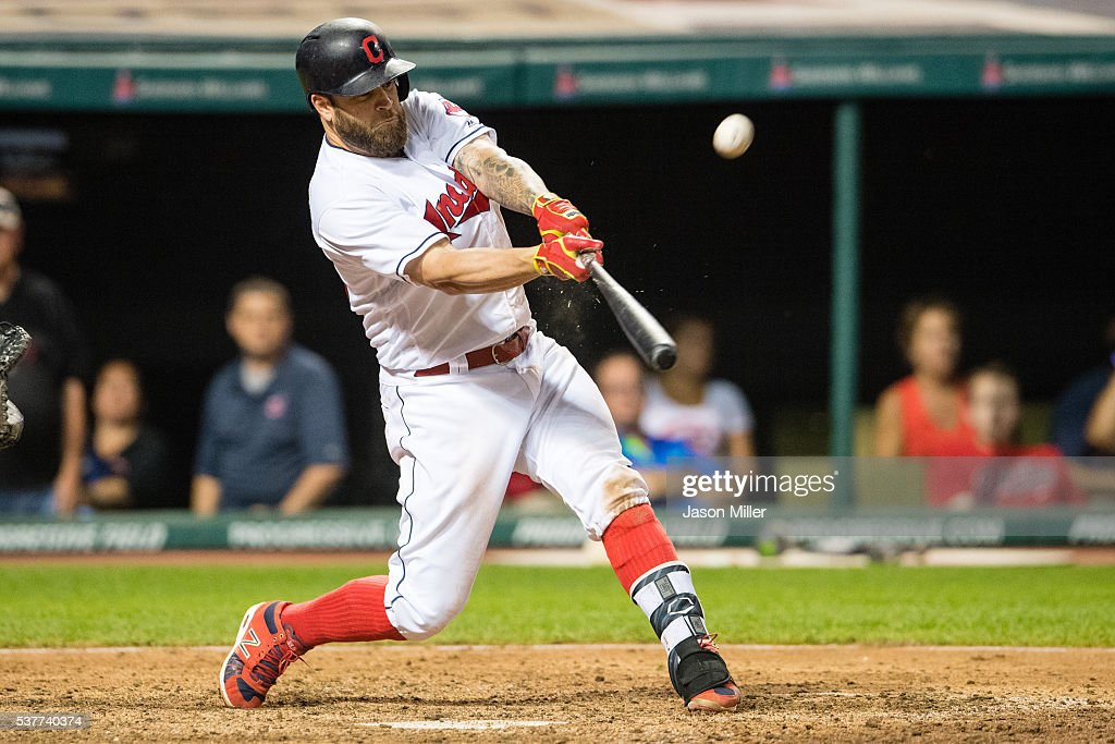 Mike Napoli #26 of the Cleveland Indians hits a walk-off sacrifice fly to defeat the Kansas City Royals at Progressive Field on June 2, 2016 in Cleveland, Ohio. The Indians defeated the Royals 5-4.