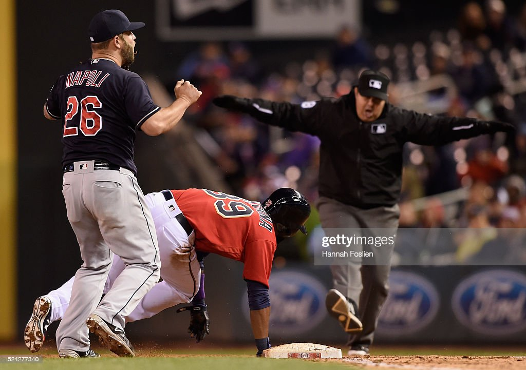 Mike Napoli #26 of the Cleveland Indians reacts as umpire Doug Eddings #88 calls Danny Santana #39 of the Minnesota Twins safe after a dive back to first base during the fifth inning of the game on April 25, 2016 at Target Field in Minneapolis, Minnesota. The Indians challenged the call and the call stood.