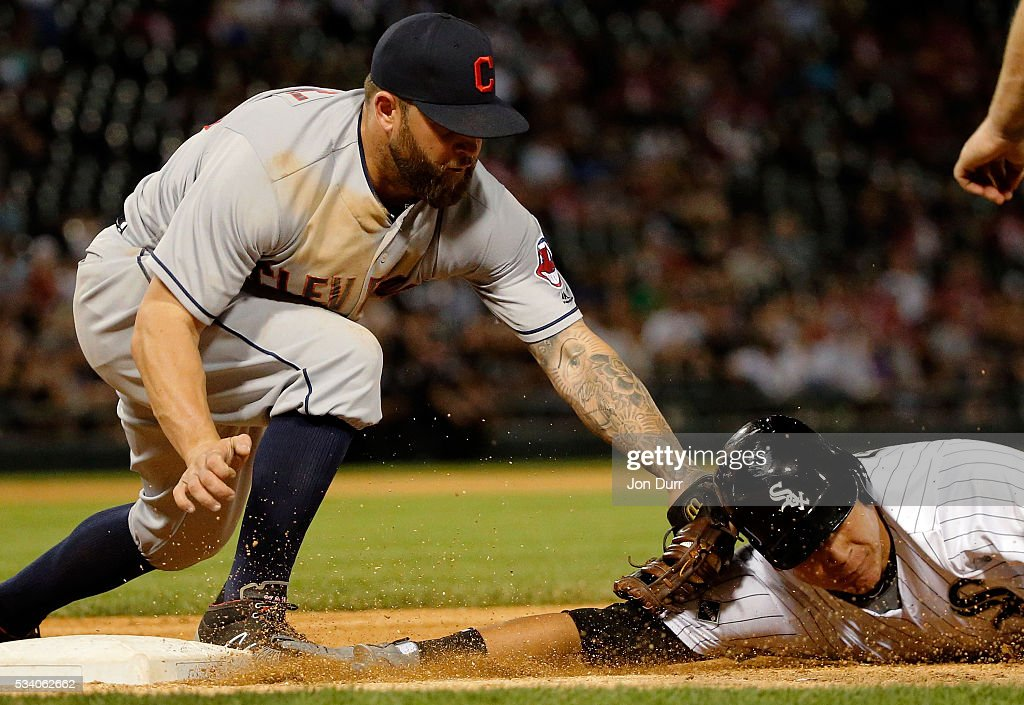 Mike Napoli #26 of the Cleveland Indians tags out Avisail Garcia #26 of the Chicago White Sox for the second out of a double play to end the fourth inning at U.S. Cellular Field on May 24, 2016 in Chicago, Illinois.