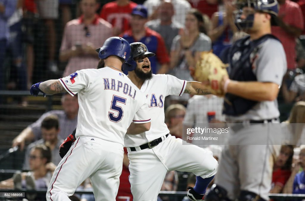 Mike Napoli #5 of the Texas Rangers celebrates a homerun with Rougned Odor #12 in the fourth inning against the Detroit Tigers at Globe Life Park in Arlington on August 15, 2017 in Arlington, Texas.
