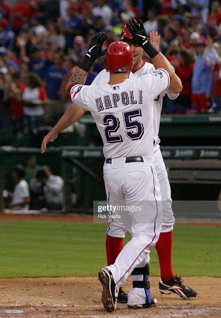 <a gi-track='captionPersonalityLinkClicked' href=/galleries/search?phrase=Mike+Napoli&family=editorial&specificpeople=525007 ng-click='$event.stopPropagation()'>Mike Napoli</a> #25 of the Texas Rangers celebrates with David Murphy #7 after hitting a three run home run in game two of the double header against the Los Angeles Angels of Anaheim at Rangers Ballpark in Arlington on September 30, 2012 in Arlington, Texas.