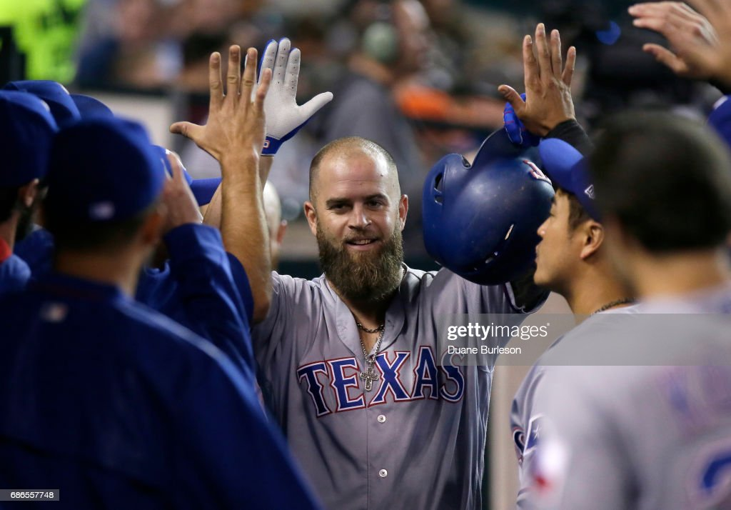 Mike Napoli #5 of the Texas Rangers celebrates with teammates after hitting a solo home run against the Detroit Tigers during the fifth inning at Comerica Park on May 21, 2017 in Detroit, Michigan. The Rangers defeated the Tigers 5-2.