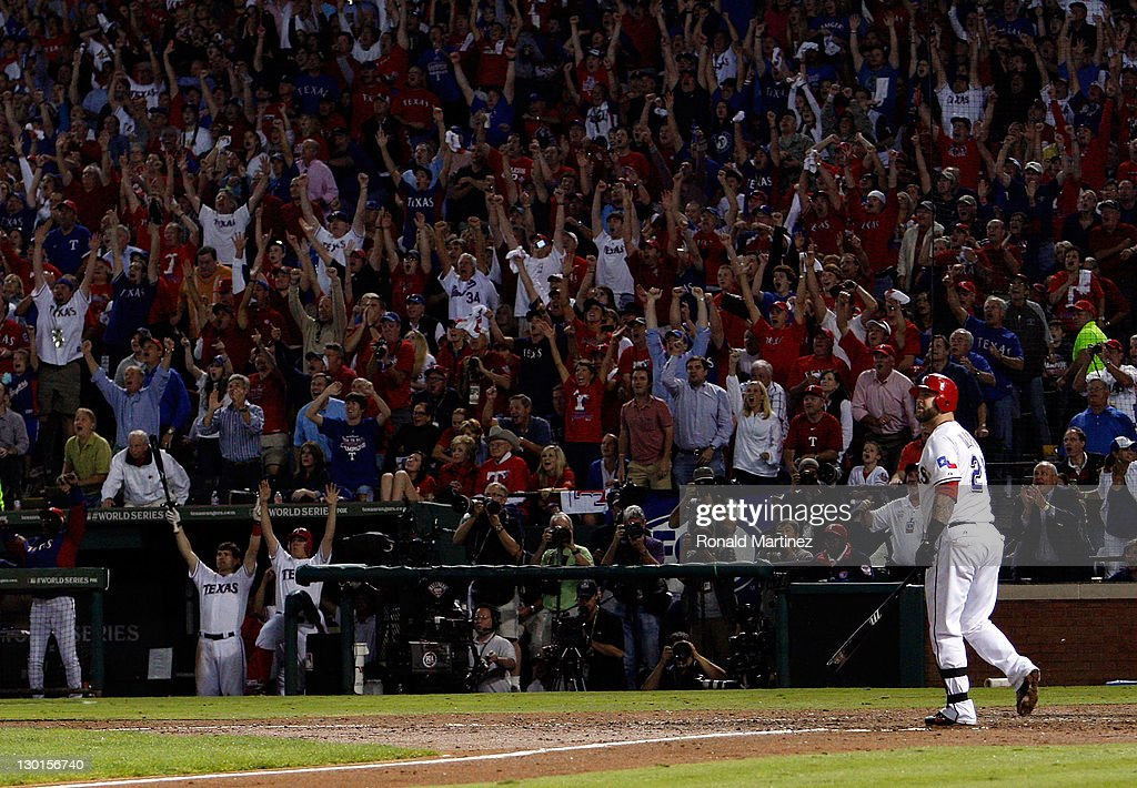 Mike Napoli of the Texas Rangers hits a threerun home run in the sixth inning during Game Four of the MLB World Series against the St Louis Cardinals...