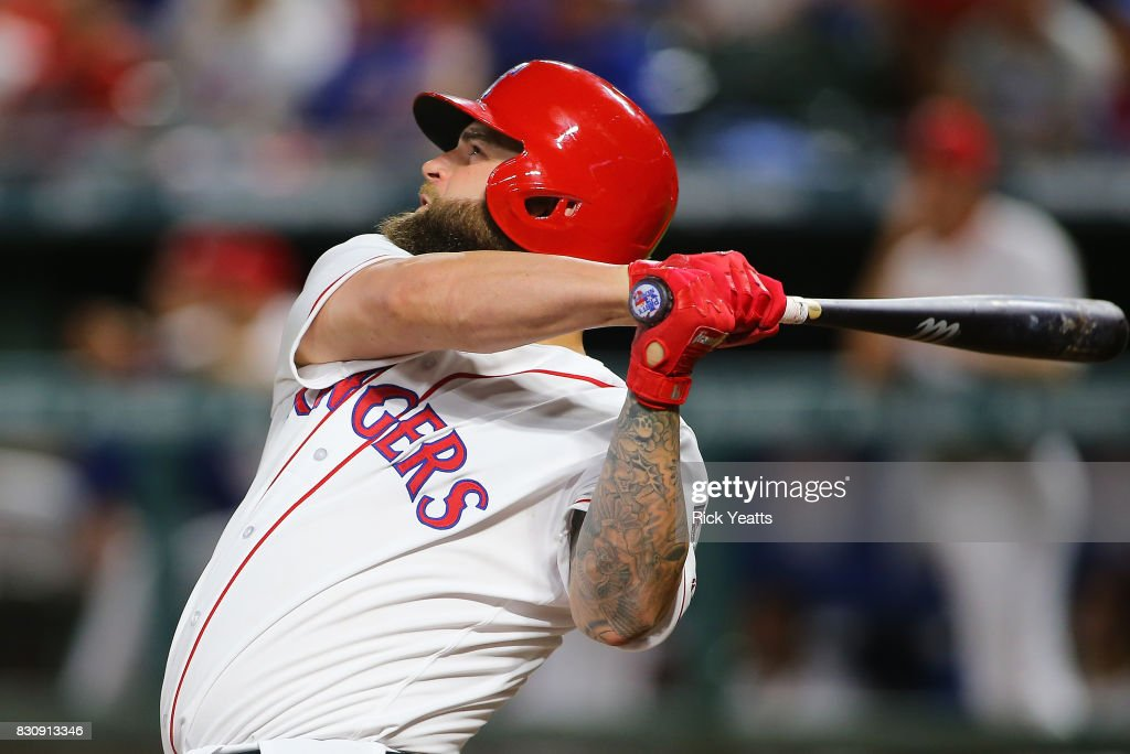 Mike Napoli #5 of the Texas Rangers in the fourth inning hits a solo home run against the Houston Astros at Globe Life Park in Arlington on August 12, 2017 in Arlington, Texas.