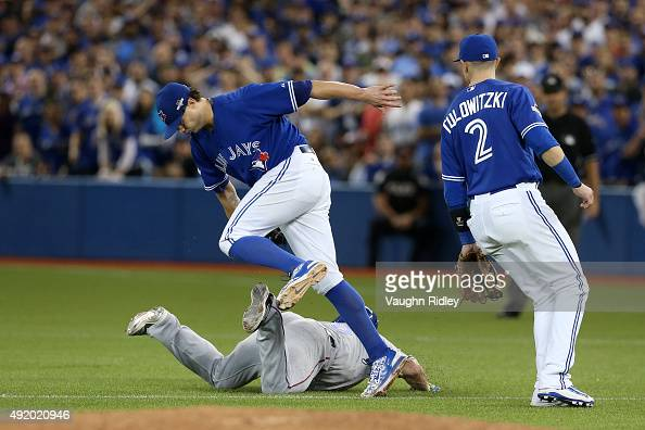 Mike Napoli of the Texas Rangers is tagged out after being caught in a rundown by Brett Cecil of the Toronto Blue Jays in the eighth inning during...