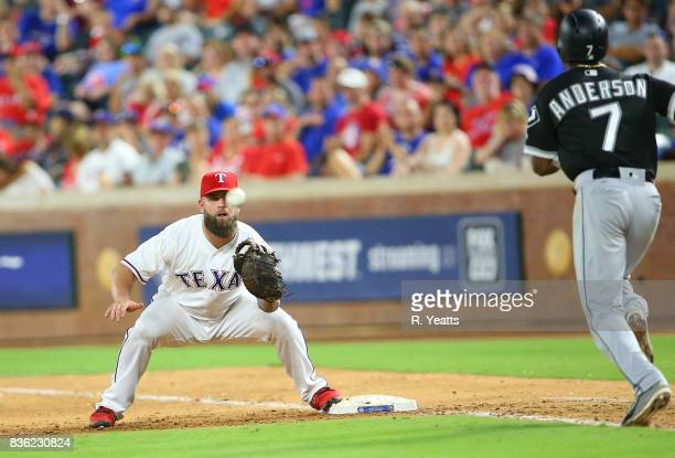 Mike Napoli of the Texas Rangers makes the catch for the out in the sixth inning on Tim Anderson of the Chicago White Sox at Globe Life Park in...