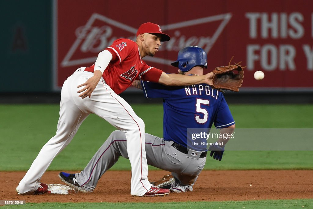 Mike Napoli #5 of the Texas Rangers steals second base ahead of the throw to Andrelton Simmons #2 of the Los Angeles Angels of Anaheim in the second inning at Angel Stadium of Anaheim on August 22, 2017 in Anaheim, California.