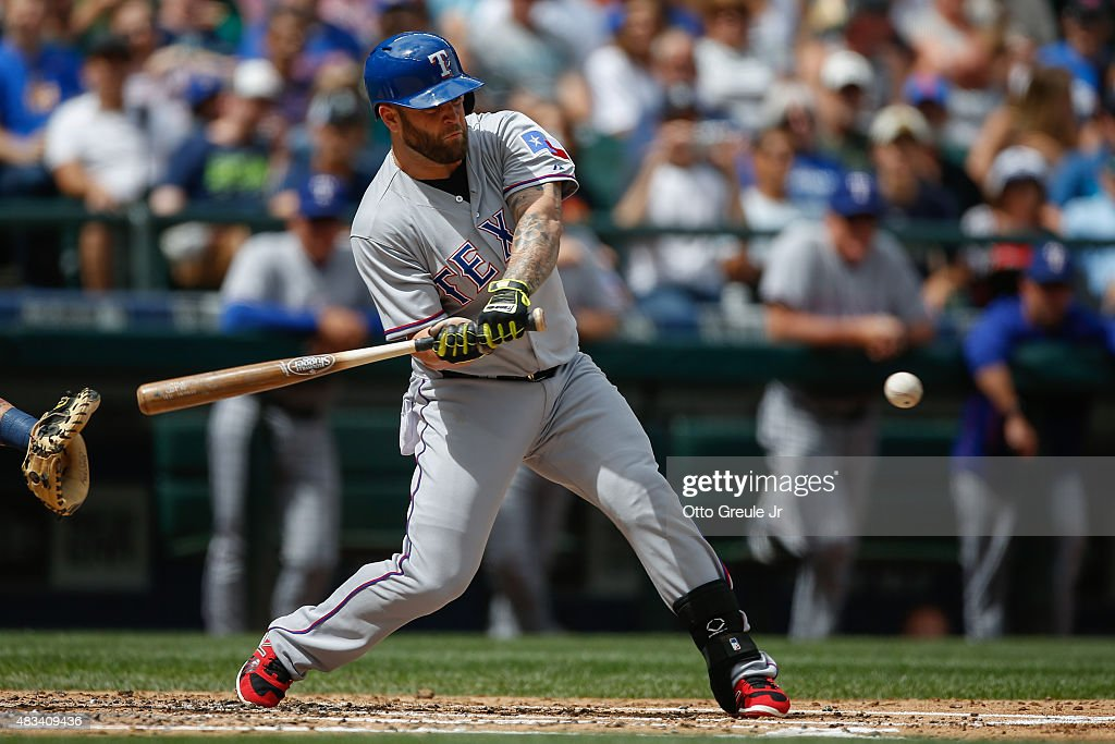 Mike Napoli #25 of the Texas Rangers strikes out in the second inning against the Seattle Mariners at Safeco Field on August 8, 2015 in Seattle, Washington.