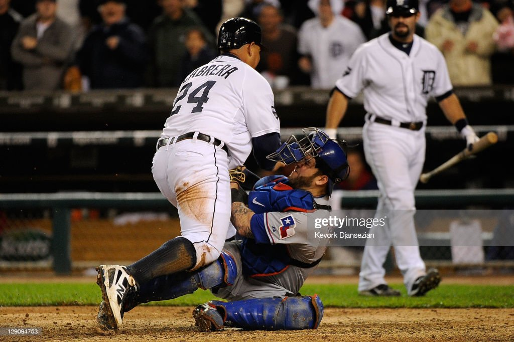Mike Napoli of the Texas Rangers tags out Miguel Cabrera of the Detroit Tigers at home plate for the final out of the eighth inning of Game Four of...