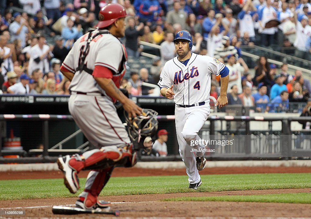 Mike Nickeas #4 of the New York Mets scores his teams fourth run in the fourth inning past <a gi-track='captionPersonalityLinkClicked' href=/galleries/search?phrase=Henry+Blanco&family=editorial&specificpeople=211366 ng-click='$event.stopPropagation()'>Henry Blanco</a> #12 of the Arizona Diamondbacks at Citi Field on May 5, 2012 in the Flushing neighborhood of the Queens borough of New York City. The Mets defeated the Diamondbacks 4-3.