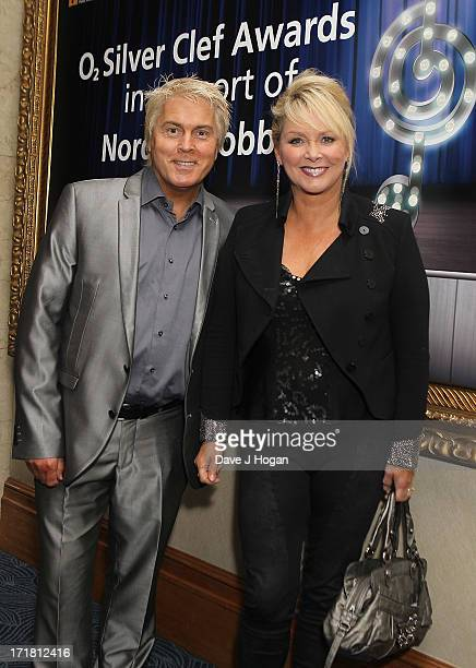 Mike Nolan and Cheryl Baker of Bucks Fizz attending the Nordoff Robbins Silver Clef Awards at London Hilton on June 28 2013 in London England