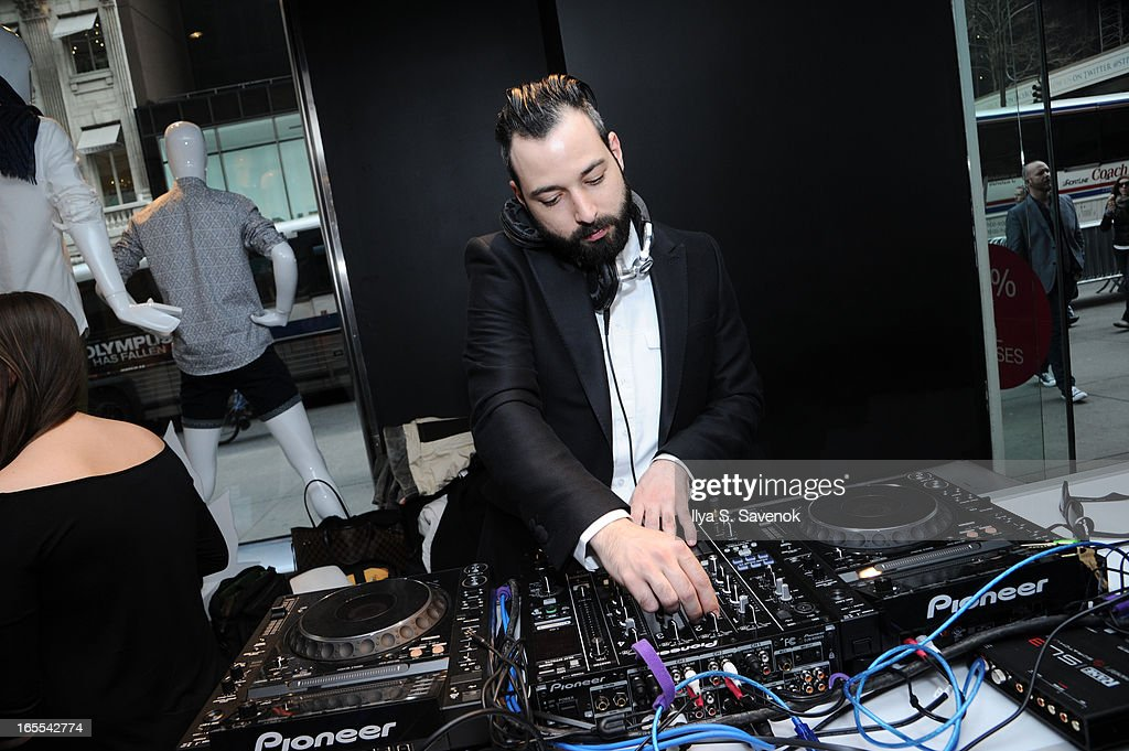 DJ Mike Nouveau performs at H&M's Conscious Collection Launch Event at H&M Fifth Avenue on April 4, 2013 in New York City.
