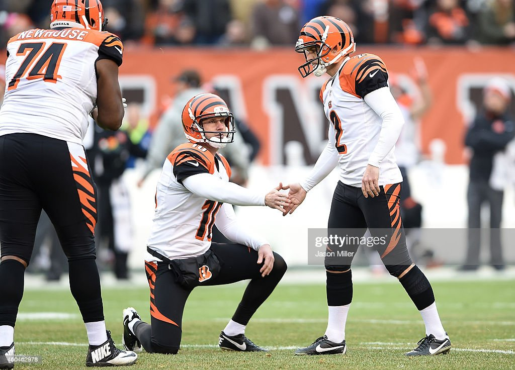 <a gi-track='captionPersonalityLinkClicked' href=/galleries/search?phrase=Mike+Nugent&family=editorial&specificpeople=2129451 ng-click='$event.stopPropagation()'>Mike Nugent</a> #2 of the Cincinnati Bengals celebrates with <a gi-track='captionPersonalityLinkClicked' href=/galleries/search?phrase=Kevin+Huber&family=editorial&specificpeople=5599507 ng-click='$event.stopPropagation()'>Kevin Huber</a> #10 after a 44 yard field goal against the Cleveland Browns at FirstEnergy Stadium on December 14, 2014 in Cleveland, Ohio.