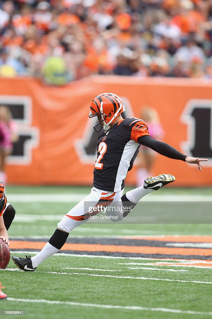 <a gi-track='captionPersonalityLinkClicked' href=/galleries/search?phrase=Mike+Nugent&family=editorial&specificpeople=2129451 ng-click='$event.stopPropagation()'>Mike Nugent</a> #2 of the Cincinnati Bengals connects for a field goal during the game against the New England Patriots at Paul Brown Stadium on October 6, 2013 in Cincinnati, Ohio.