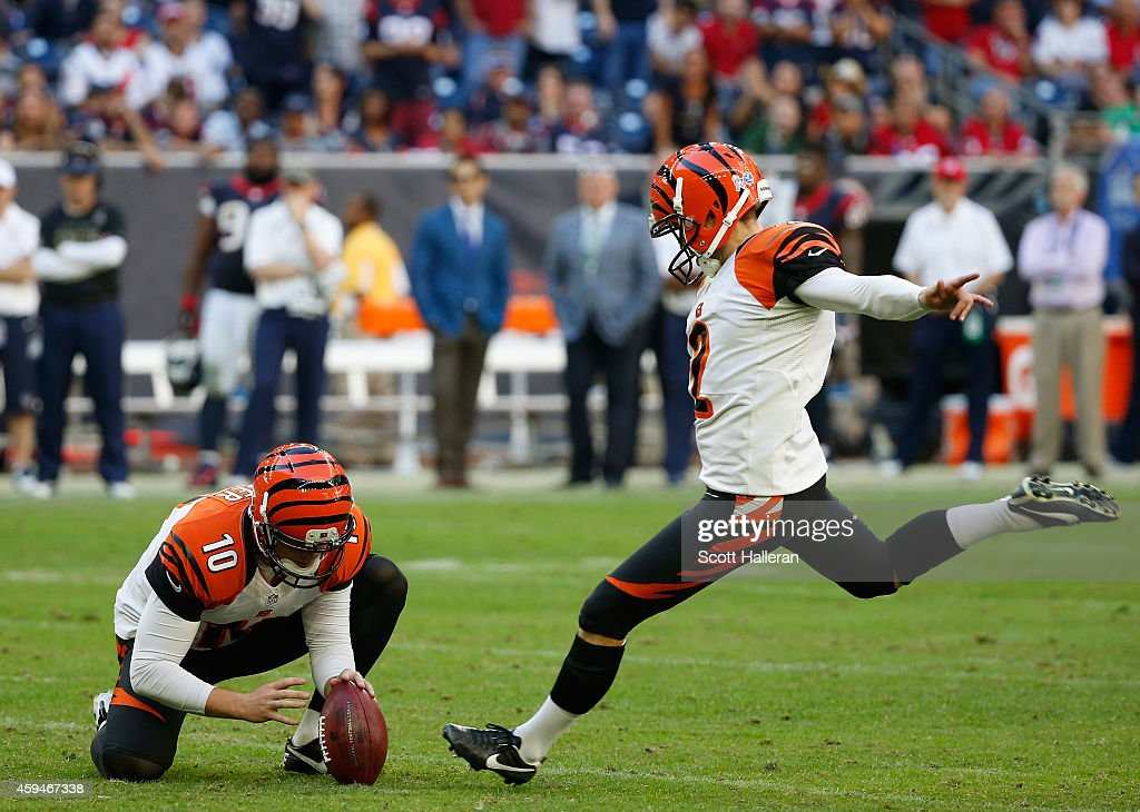<a gi-track='captionPersonalityLinkClicked' href=/galleries/search?phrase=Mike+Nugent&family=editorial&specificpeople=2129451 ng-click='$event.stopPropagation()'>Mike Nugent</a> #2 of the Cincinnati Bengals kicks a 49-yard field goal in the second half of their game against the Houston Texans at NRG Stadium on November 23, 2014 in Houston, Texas.