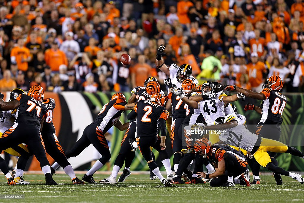 <a gi-track='captionPersonalityLinkClicked' href=/galleries/search?phrase=Mike+Nugent&family=editorial&specificpeople=2129451 ng-click='$event.stopPropagation()'>Mike Nugent</a> #2 of the Cincinnati Bengals kicks a field goal during the second quarter against the Pittsburgh Steelers on September 16, 2013 at Paul Brown Stadium on September 16, 2013 in Cincinnati, Ohio.