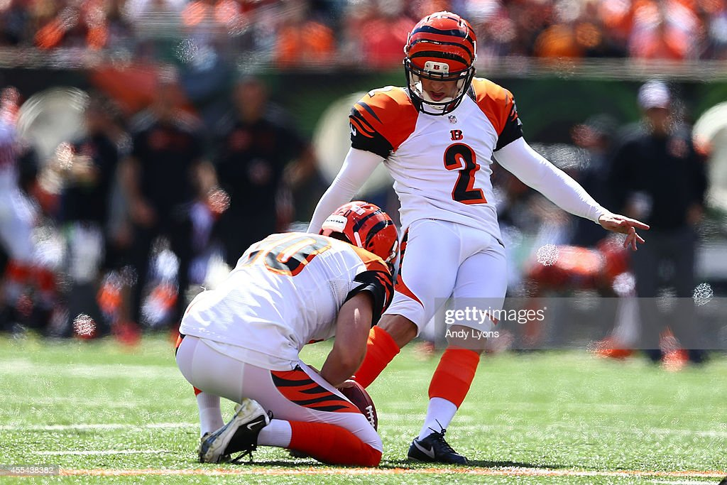 <a gi-track='captionPersonalityLinkClicked' href=/galleries/search?phrase=Mike+Nugent&family=editorial&specificpeople=2129451 ng-click='$event.stopPropagation()'>Mike Nugent</a> #2 of the Cincinnati Bengals kicks a field goal during the first quarter against the Atlanta Falcons at Paul Brown Stadium on September 14, 2014 in Cincinnati, Ohio.