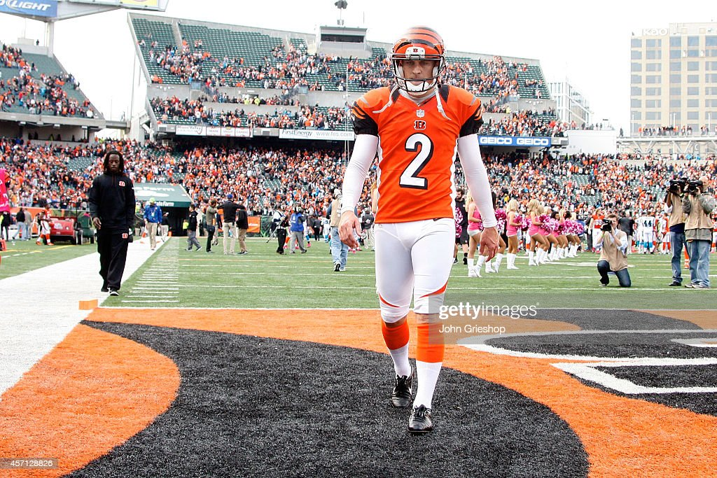 <a gi-track='captionPersonalityLinkClicked' href=/galleries/search?phrase=Mike+Nugent&family=editorial&specificpeople=2129451 ng-click='$event.stopPropagation()'>Mike Nugent</a> #2 of the Cincinnati Bengals walks off of the field after missing what would have been the game-winning field goal attempt in overtime against the Carolina Panthers at Paul Brown Stadium on October 12, 2014 in Cincinnati, Ohio. Cincinnati and Carolina tied 37-37.