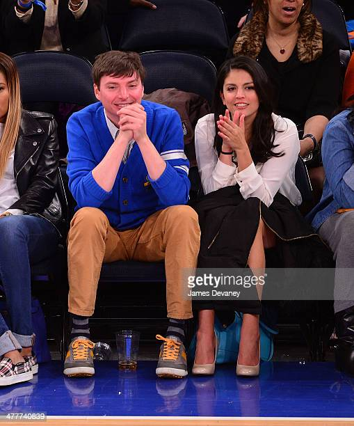 Mike O'Brien and Cecily Strong attend the Philadelphia 76ers vs New York Knicks game at Madison Square Garden on March 10 2014 in New York City