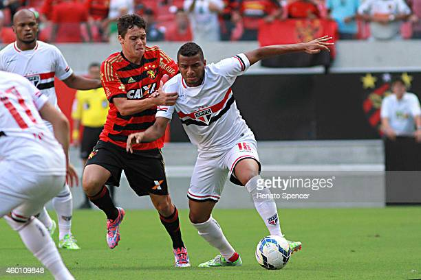 Mike of Sport Recife battles for the ball with Reinaldo of Sao Paulo during the Brasileirao Series A 2014 match between Sport Recife and Sao Paulo at...