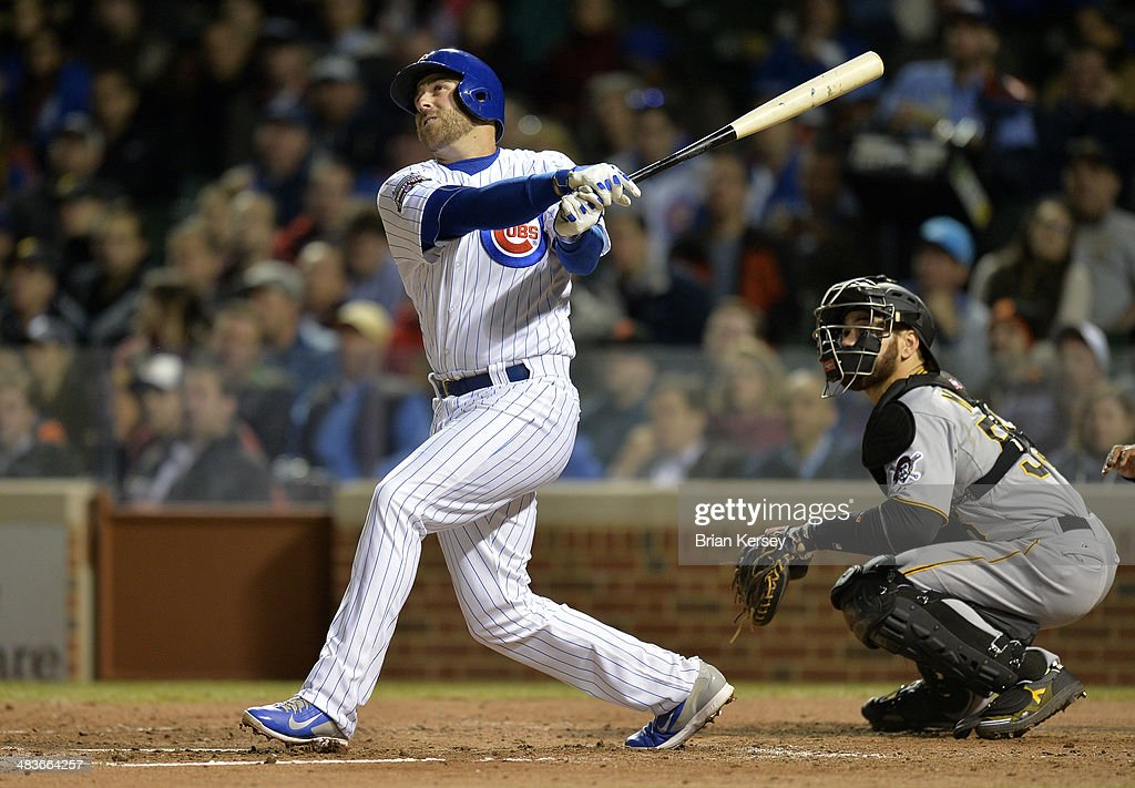 <a gi-track='captionPersonalityLinkClicked' href=/galleries/search?phrase=Mike+Olt&family=editorial&specificpeople=9013251 ng-click='$event.stopPropagation()'>Mike Olt</a> #30 of the Chicago Cubs follows through on a two-run home run scoring teammate Anthony Rizzo #44 during the fifth inning against the Pittsburgh Pirates at Wrigley Field on April 9, 2014 in Chicago, Illinois.